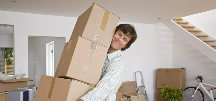 Man carrying heavy moving boxes